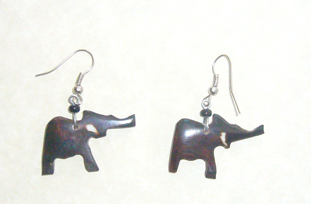 A Must For Elephant Lovers, These Eye Catching Earrings Are Made From  Polished Brown Bone Bead, With Batik Design And Set Onto Surgical Wires.